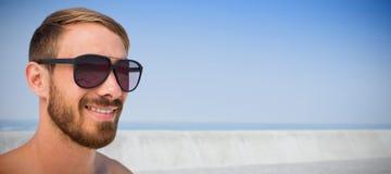 Imagem composta de vidros de sol vestindo do homem elegante Fotos de Stock Royalty Free