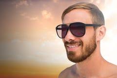 Imagem composta de vidros de sol vestindo do homem elegante Fotografia de Stock
