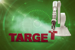 Imagem composta do braço robótico que arranja o texto de alvo 3d Imagem de Stock Royalty Free