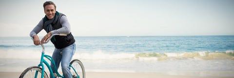Imagem composta do composto digital do homem considerável em um passeio da bicicleta fotografia de stock royalty free