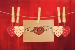 Imagem composta do coração com asas Imagens de Stock
