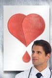 A imagem composta do doutor seguro com braços cruzou a vista acima fotografia de stock