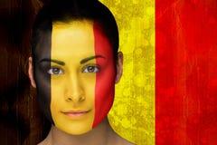 Imagem composta do fan de futebol bonito na pintura da cara imagens de stock
