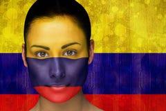 Imagem composta do fan de futebol bonito na pintura da cara imagens de stock royalty free