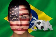 Imagem composta do fan de futebol de América na pintura da cara Imagem de Stock