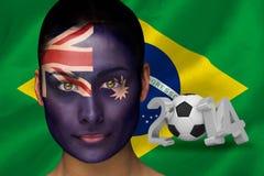 Imagem composta do fan de futebol de Austrália na pintura da cara Foto de Stock
