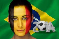 Imagem composta do fan de futebol de Bélgica na pintura da cara Imagens de Stock