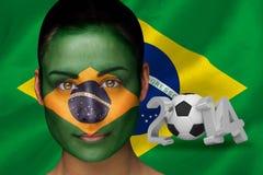 Imagem composta do fan de futebol de Brasil na pintura da cara Fotos de Stock Royalty Free