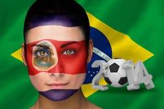 Imagem composta do fan de futebol de Costa-Rica na pintura da cara Foto de Stock