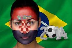Imagem composta do fan de futebol de croatia na pintura da cara Fotos de Stock Royalty Free