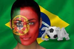 Imagem composta do fan de futebol de Portugal na pintura da cara Imagem de Stock