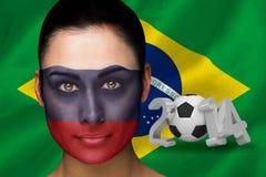 Imagem composta do fan de futebol de Rússia na pintura da cara Imagem de Stock Royalty Free