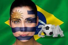Imagem composta do fan de futebol de Uruguai na pintura da cara Foto de Stock