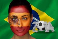 Imagem composta do fan de futebol espanhol na pintura da cara Foto de Stock