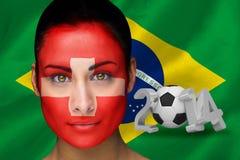 Imagem composta do fan de futebol suíço na pintura da cara Fotografia de Stock Royalty Free
