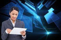 Imagem composta do fim acima da vendedora com computador do tela táctil Imagens de Stock Royalty Free