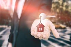Imagem composta do fim acima do keychain home vermelho com chave de prata Fotografia de Stock Royalty Free