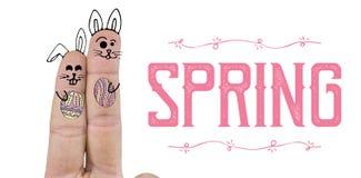 Imagem composta do fim acima dos dedos que representam o coelhinho da Páscoa Imagens de Stock Royalty Free