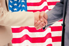 Imagem composta do fim acima dos povos que agitam as mãos Imagem de Stock Royalty Free