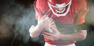 Imagem composta do futebol de proteção do jogador de futebol americano Foto de Stock Royalty Free