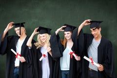 Imagem composta do grupo de adolescentes que comemoram após a graduação fotografia de stock royalty free
