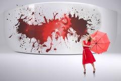 Imagem composta do guarda-chuva guardando louro elegante Imagens de Stock