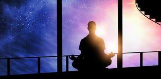 Imagem composta do homem da silhueta que faz a meditação Fotografia de Stock Royalty Free
