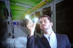 Imagem composta do homem de negócios concentrado que mede algo com seus dedos Fotografia de Stock Royalty Free