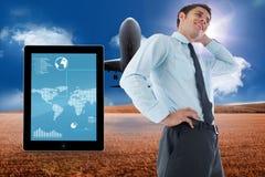 Imagem composta do homem de negócios de pensamento com mão na cabeça Imagens de Stock