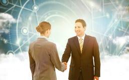 Imagem composta do homem de negócios de sorriso que agita as mãos com colega Imagens de Stock