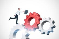 Imagem composta do homem de negócios feliz que pula com sua pasta Imagens de Stock Royalty Free