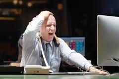 Imagem composta do homem de negócios forçada para fora no trabalho fotos de stock