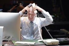 Imagem composta do homem de negócios forçada para fora no trabalho fotografia de stock