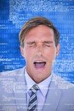 Imagem composta do homem de negócios forçado que obtém uma dor de cabeça fotos de stock royalty free