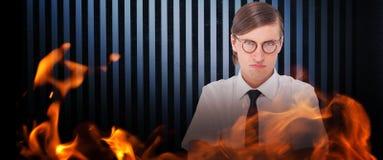 Imagem composta do homem de negócios geeky que olha a câmera com os braços cruzados Fotos de Stock Royalty Free