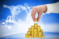 Imagem composta do homem de negócios que guarda moedas Imagem de Stock Royalty Free