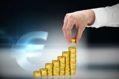 Imagem composta do homem de negócios que guarda moedas Fotografia de Stock Royalty Free