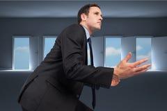 Imagem composta do homem de negócios que levanta com braços para fora Fotografia de Stock