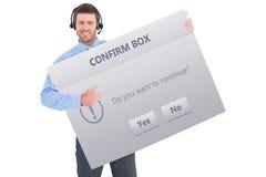 Imagem composta do homem de negócios que mostra auriculares vestindo do cartão Fotos de Stock Royalty Free