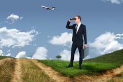 Imagem composta do homem de negócios que olha através dos binóculos Foto de Stock Royalty Free