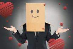 Imagem composta do homem de negócios que shrugging com a caixa na cabeça Fotografia de Stock