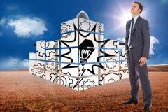 Imagem composta do homem de negócios sério com mão no bolso Imagens de Stock Royalty Free