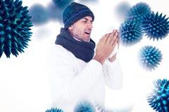 Imagem composta do homem doente em espirrar da forma do inverno foto de stock