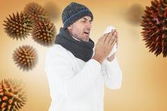 Imagem composta do homem doente em espirrar da forma do inverno fotografia de stock royalty free