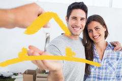 Imagem composta do homem feliz que está sendo dado uma chave da casa Fotos de Stock Royalty Free
