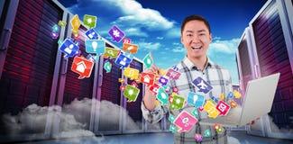 Imagem composta do homem feliz que guarda o portátil e que aponta 3d Foto de Stock