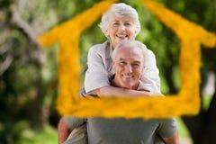 Imagem composta do homem que dá a esposa um reboque Fotografia de Stock Royalty Free