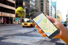 Imagem composta do homem que usa o mapa app no telefone Fotos de Stock Royalty Free