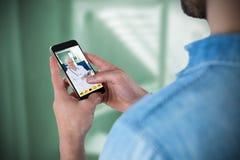 Imagem composta do homem que usa o telefone celular Imagens de Stock Royalty Free