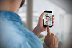 Imagem composta do homem que usa o telefone celular Imagem de Stock Royalty Free